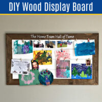 This easy DIY Wood Display Board or Noticeboard is a pretty way to get organized or show off your family photos, awards, and memories!
