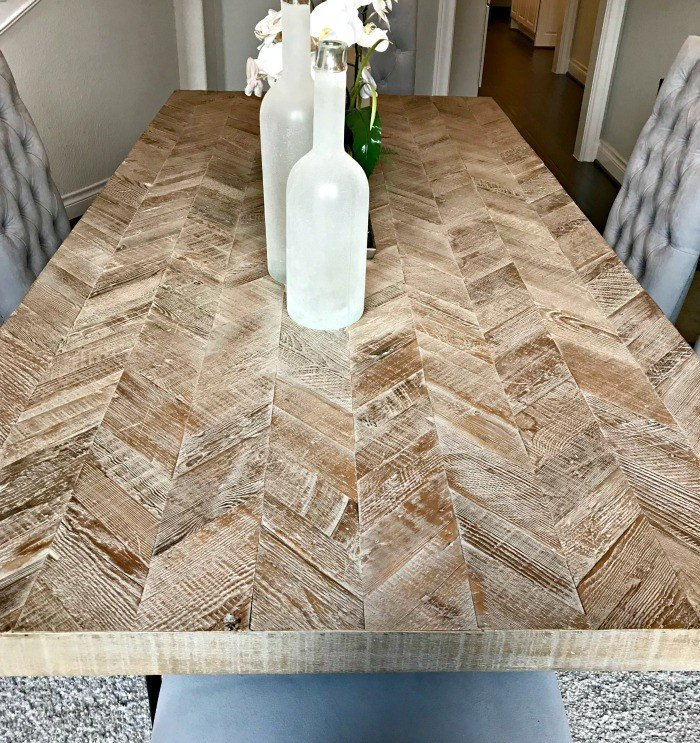 Whitewashed Herringbone Dining Table Design. Check out this photo tour from Model Homes with Beautiful Furniture and Home Interior Design Ideas that I love!