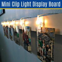 Make this Easy DIY Mini Clip Light Display Board. I love this easy home decor idea for bedrooms, dorm rooms, living rooms, and an office! Easy DIY Home Decor Idea using mini LED string lights.