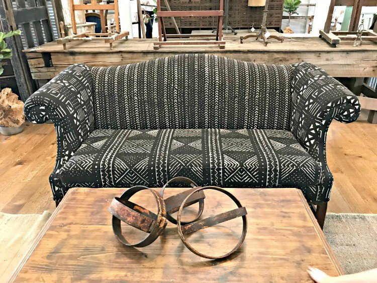 Black and white tribal prints on a small love seat or couch. The Spring and Fall Round Top Texas Antiques and Flea Markets are great! BUT you can find Fun, Art & Furniture Shopping in Round Top, Texas year round, guys! Check out photos from the shops in town. #RoundTop #TexasTravel #AbbottsAtHome