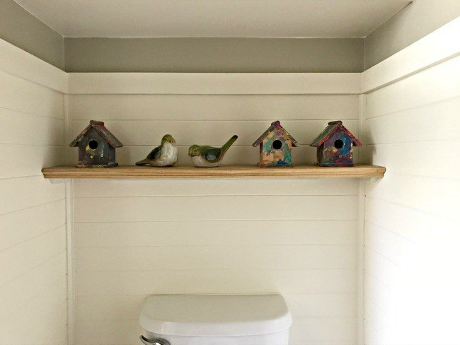 Build this Quick and Easy DIY Bathroom Shelf over your Toilet for extra storage or a little Modern Farmhouse Style. No Special Hardware Required. #AbbottsAtHome #DIYShelf #EasyDIYProject #ModernFarmhouse