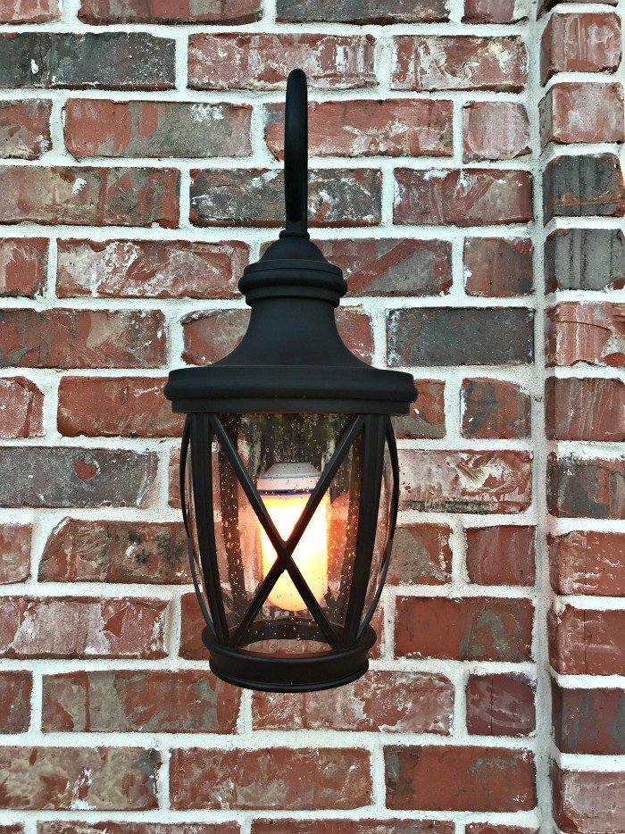 We love this beautiful Allen + Roth Rubbed Bronze and Seeded Glass Front Porch Light. It's completely transformed our porch. Instant curb appeal, guys! #AbbottsAtHome #CurbAppealIdeas #Lighting #PorchIdeas