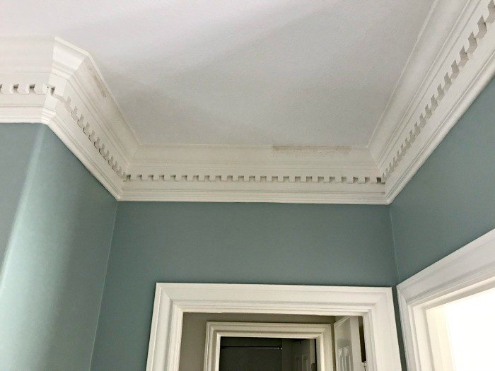 How a light colored paint scheme has transformed this home and even made the crown molding and millwork pop! #LightWalls #WhiteWalls #GreyWalls #PaintIdeas
