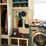 How I Added a Mudroom in our Small Laundry Room with cheap DIY projects that turned regular cabinets into a mudroom bench and coat storage. How I added a Mudroom Bench in our Small Laundry Room.