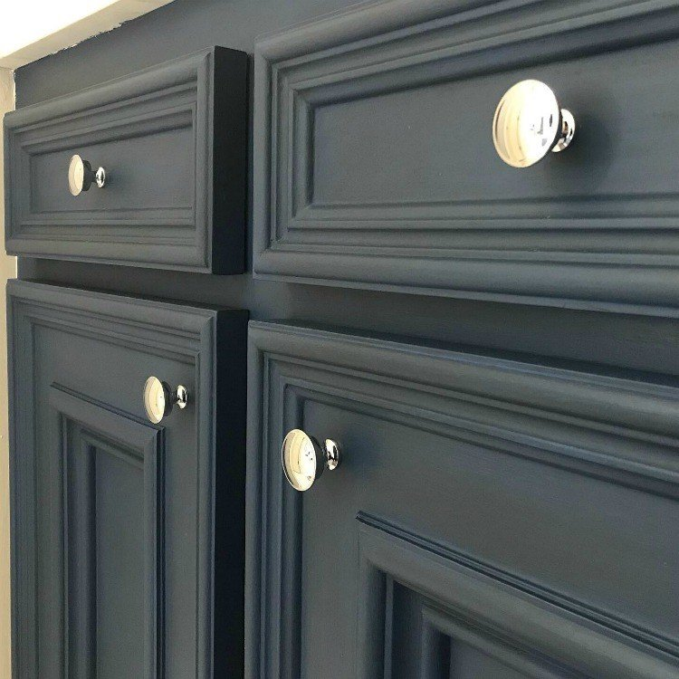 DIY Napoleonic Blue Bathroom Vanity Makeover with dark wax and pretty chrome knobs. #AbbottsAtHome #BathroomIdeas #BathroomDesign #BathroomCabinets #AnnieSloan