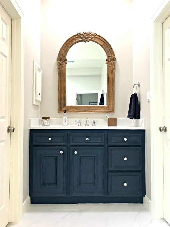 This DIY Napoleonic Blue Bathroom Vanity Makeover has completely transformed my bathroom. The color is beautiful and chalk paint is a great low budget diy project that anyone can do. #AbbottsAtHome #ChalkPaintMakeover #BathroomCabinets #BathroomVanity #BathroomRemodel