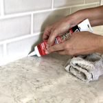 Replace your old crumbly grout or dingy caulk with this easy DIY. Here's How to Caulk A Kitchen Counter with the quick steps and video to help you do it! #AbbottsAtHome #Caulk #HomeMaintenance #DIYProject #Caulking #Kitchen