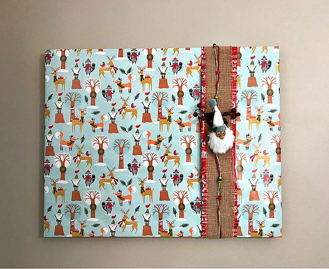 How to Wrap A Picture Frame with Wrapping Paper to make free and easy Christmas decorations. How to gift wrap your wall art with Christmas ornaments, ribbons, and gift wrap you already have. With steps and a how to video.