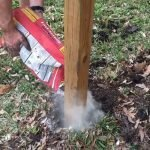 Here's how to set wooden fence posts in concrete - with written steps and a quick video to show you how to build or DIY your own Three Rail Fence or other horizontal fence ideas.