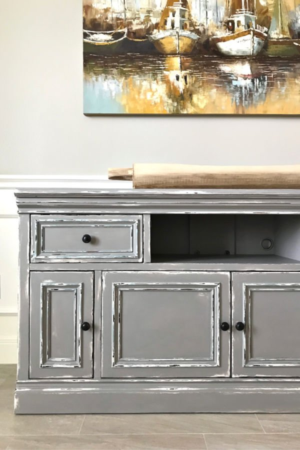 Here's my easy to follow steps for this beautiful DIY Gray Chalk Paint Furniture Makeover. With this tutorial you can distress as little or as much as you want to get the look you love. Paint layering and distressing with written steps and how to video.