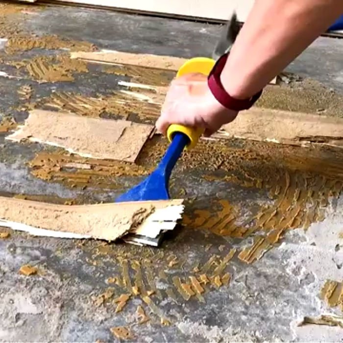 DIY tips and video showing How to Remove Glued Wood Flooring or Engineered Wood Flooring and Flooring Adhesive on Concrete.