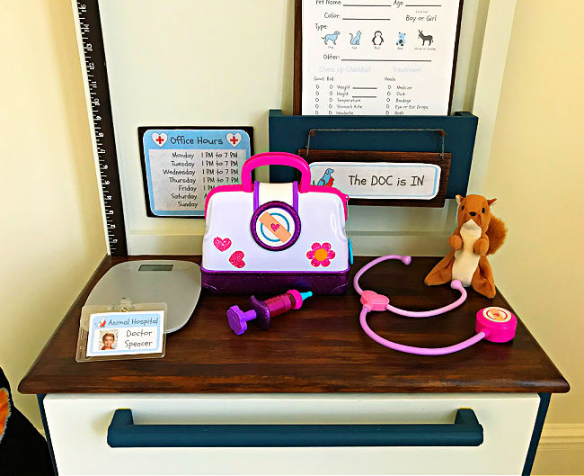 Make your kids this sweet little DIY Kids Play Pet Vet Clinic with this easy to follow beginner woodworking build plan. This DIY Kids Play Pet Hospital has been a popular playset with our little veterinarians, this year. Printable Pet Clinic Signs, Patient Forms, and Build Plans Available.