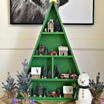 Easy woodworking steps & video for this big table top or floor-sized DIY Wood Christmas Tree Shelf. Printable woodworking plans, easy enough for beginner woodworkers. I'm loving this fun way to display all of my favorite Christmas decorations. This DIY Wood Christmas Tree Shelf is a great display for Cookies & Cocoa Bars, Christmas Villages, Advent Calendars, Christmas Ornaments and more.