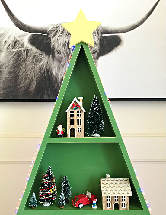 I'm loving this easy woodworking project! This DIY Wood Christmas Tree Shelf is a great display for Cocoa Bars, Christmas Villages, or Ornaments. Printable woodworking plans, easy enough for beginner woodworkers.