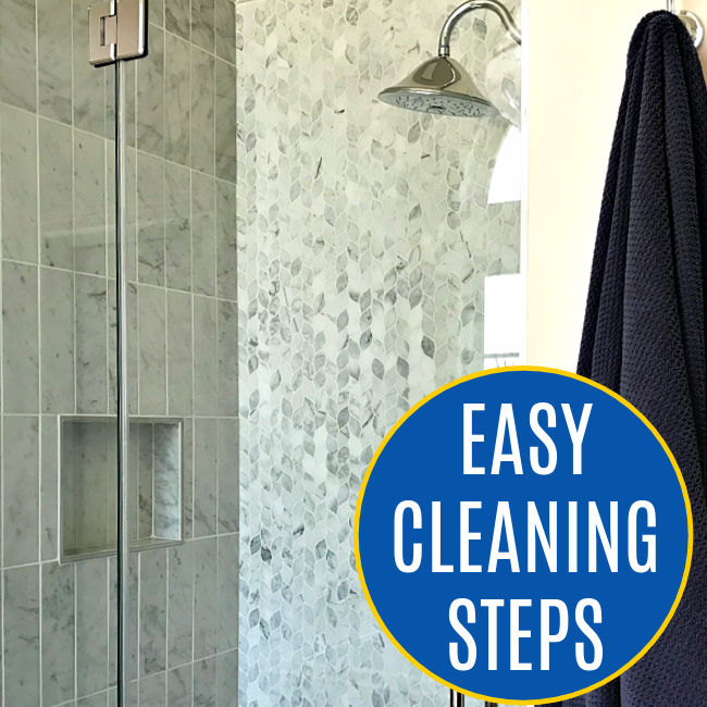 You can quickly and safely clean a shower glass door with marble or stone tile using vinegar & backing soda. But, be careful doing it! Vinegar can etch, stain, and pit your marble and stone tile. Here's a step by step guide to how to clean your glass shower door without damaging your tile.
