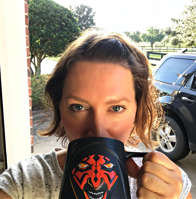 Photo of a woman drinking from a Darth Maul mug. Taken on my 43rd birthday.