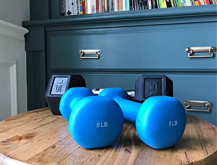 Picture of free weights. Exercise is an important part of feeling younger in your 40's.